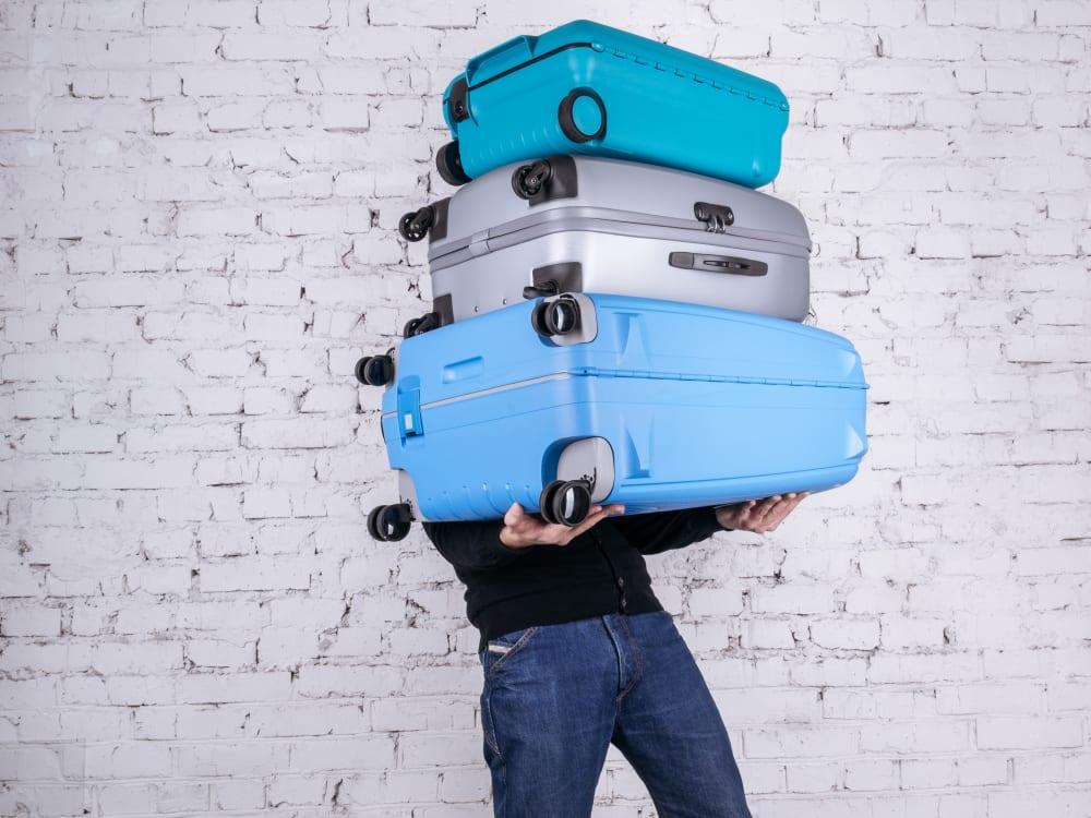 holding luggage