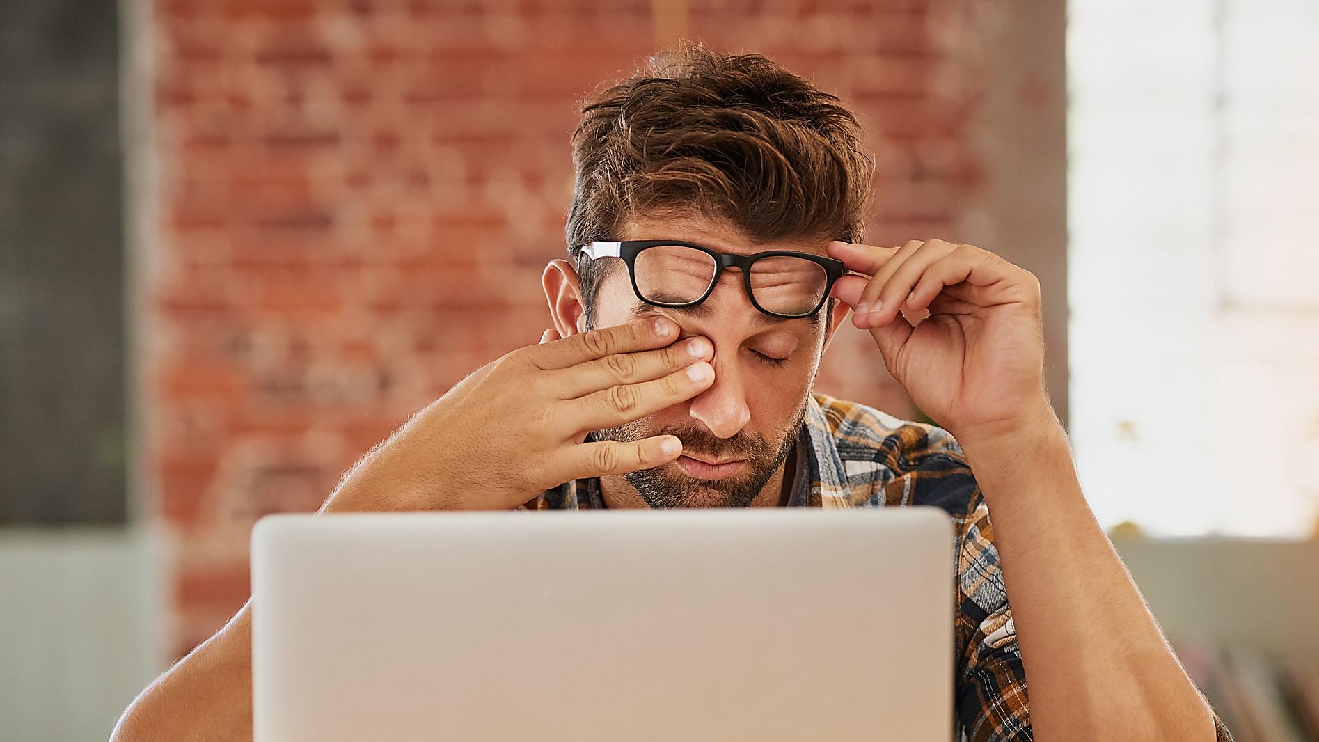 stressed man at laptop