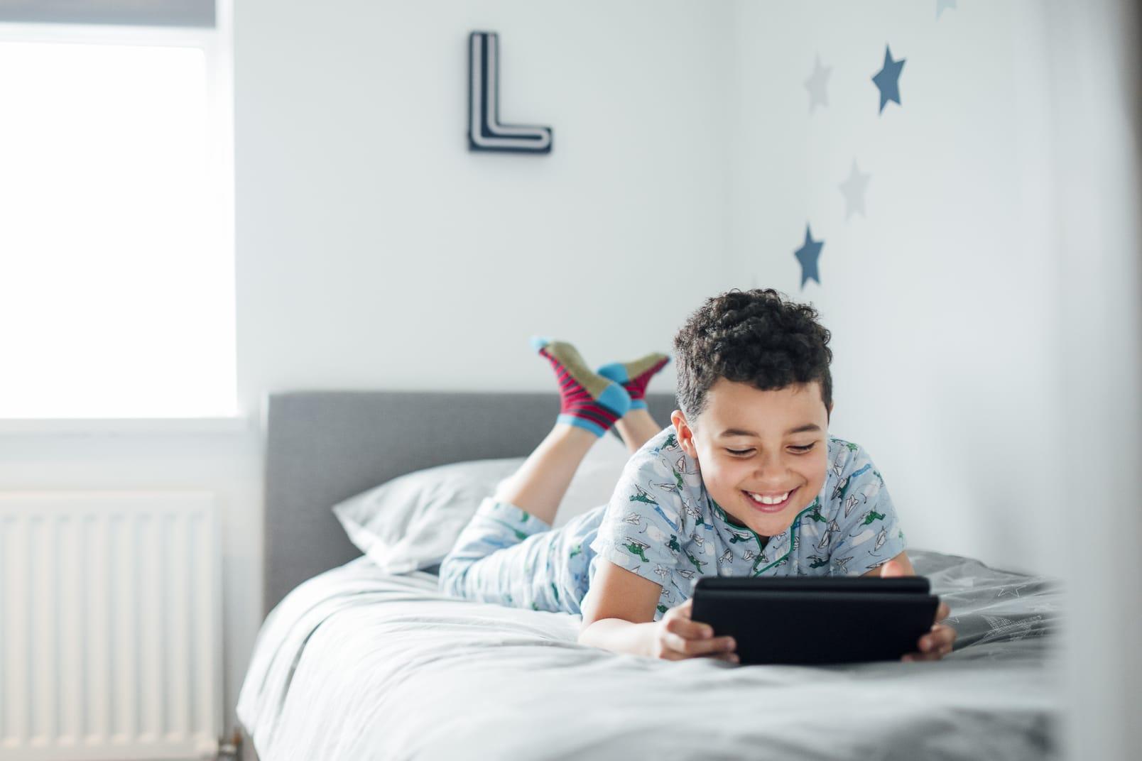 Boy Using Digital Tablet in the Morning