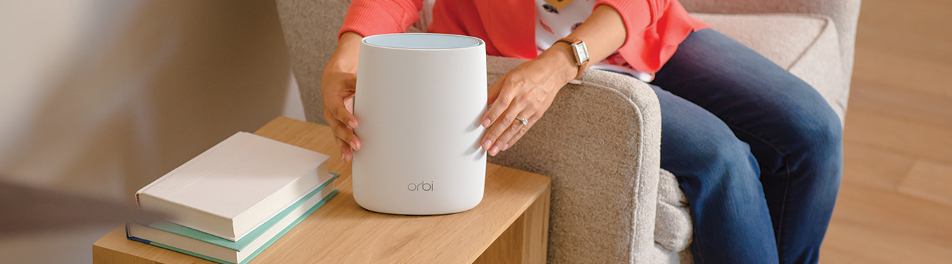Netgear Orbi WiFi and woman