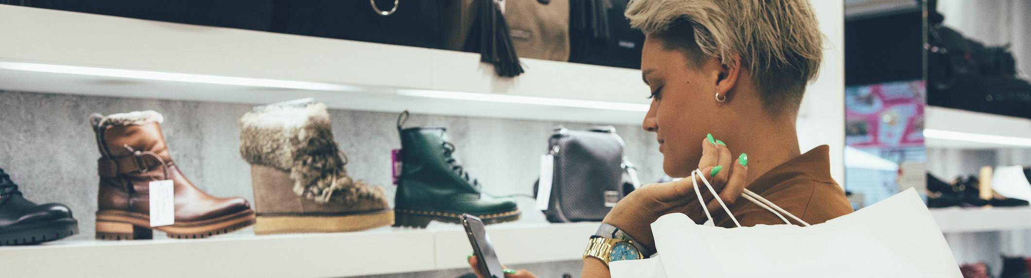 woman checking shoe price