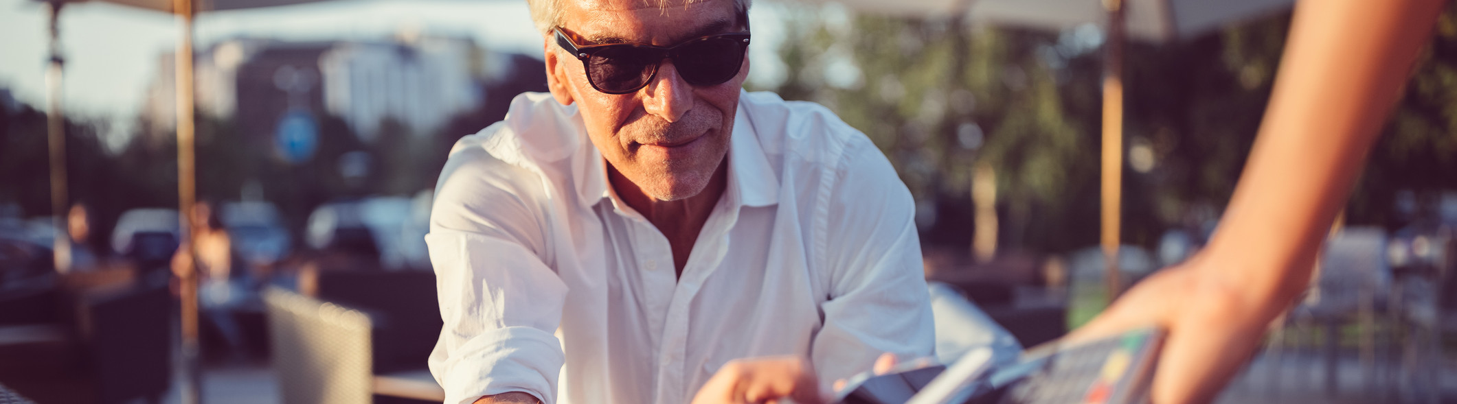 senior man using mobile payment