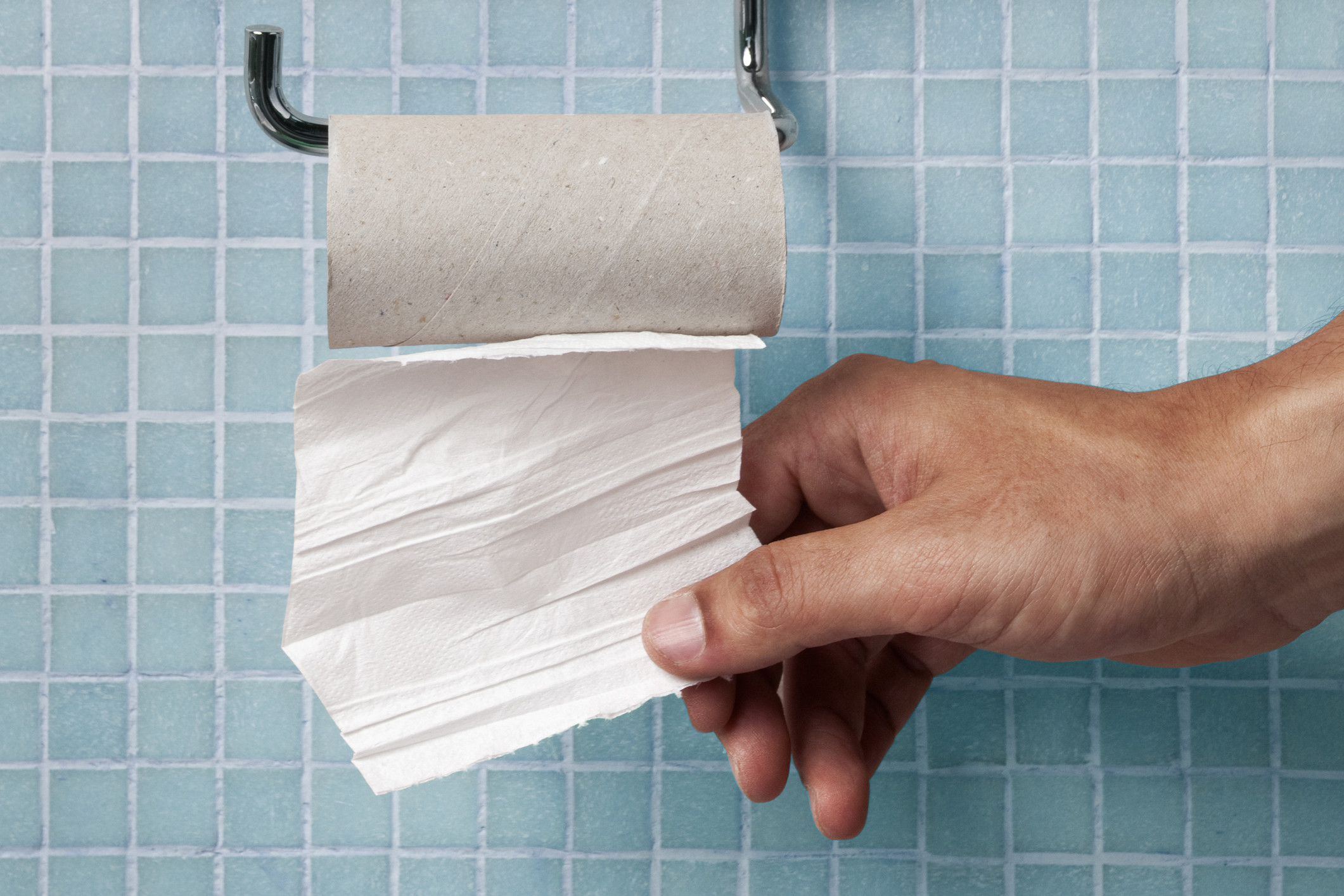 hand grabbing toilet paper