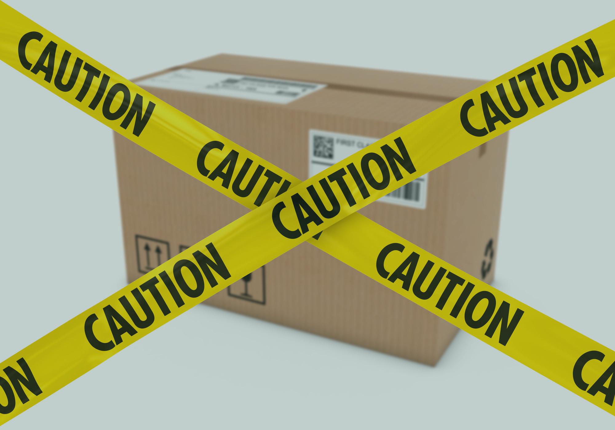 Cardboard Box Behind Caution Tape Cross