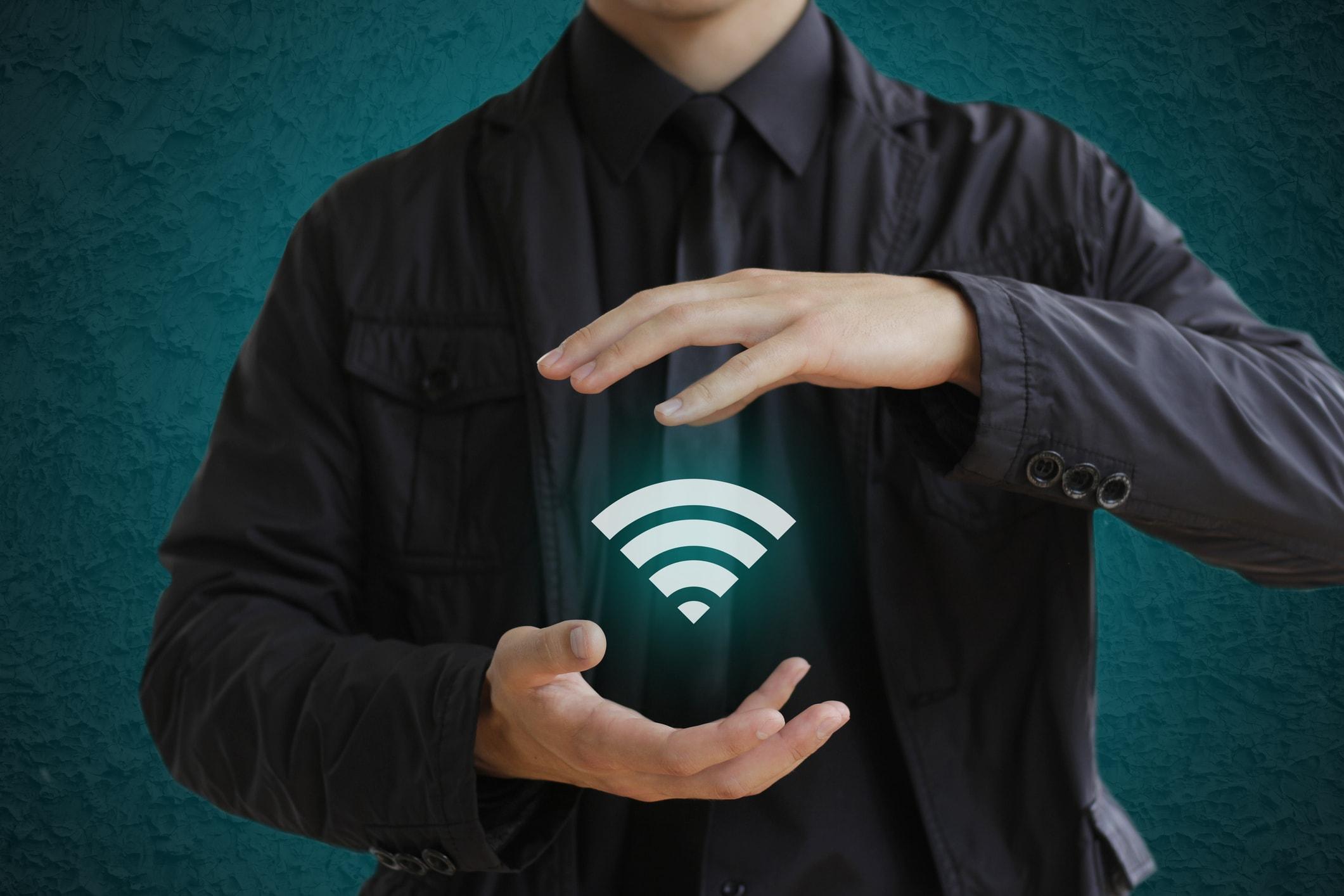 Man Holding a Wifi Icon