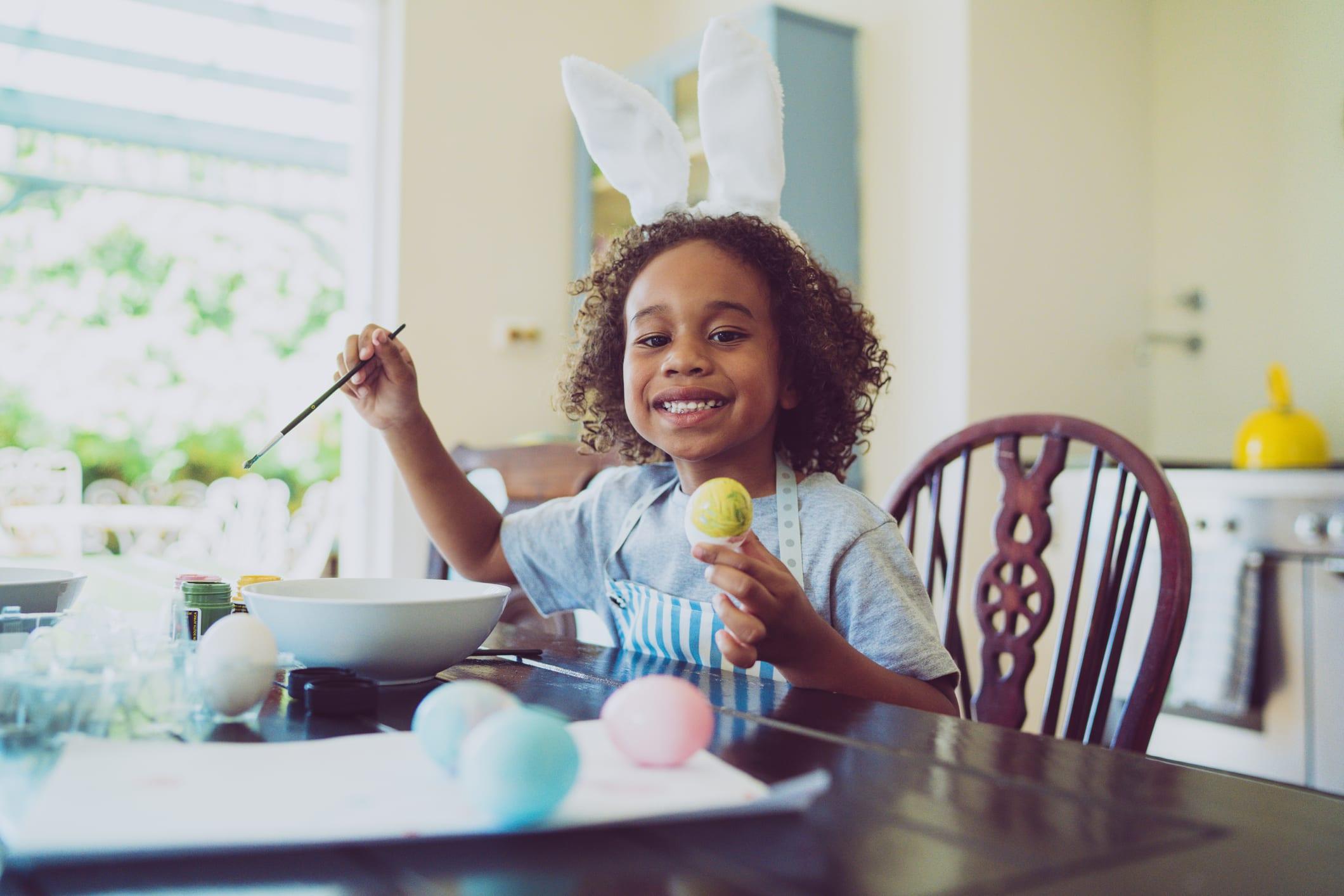 kid dyeing eggs
