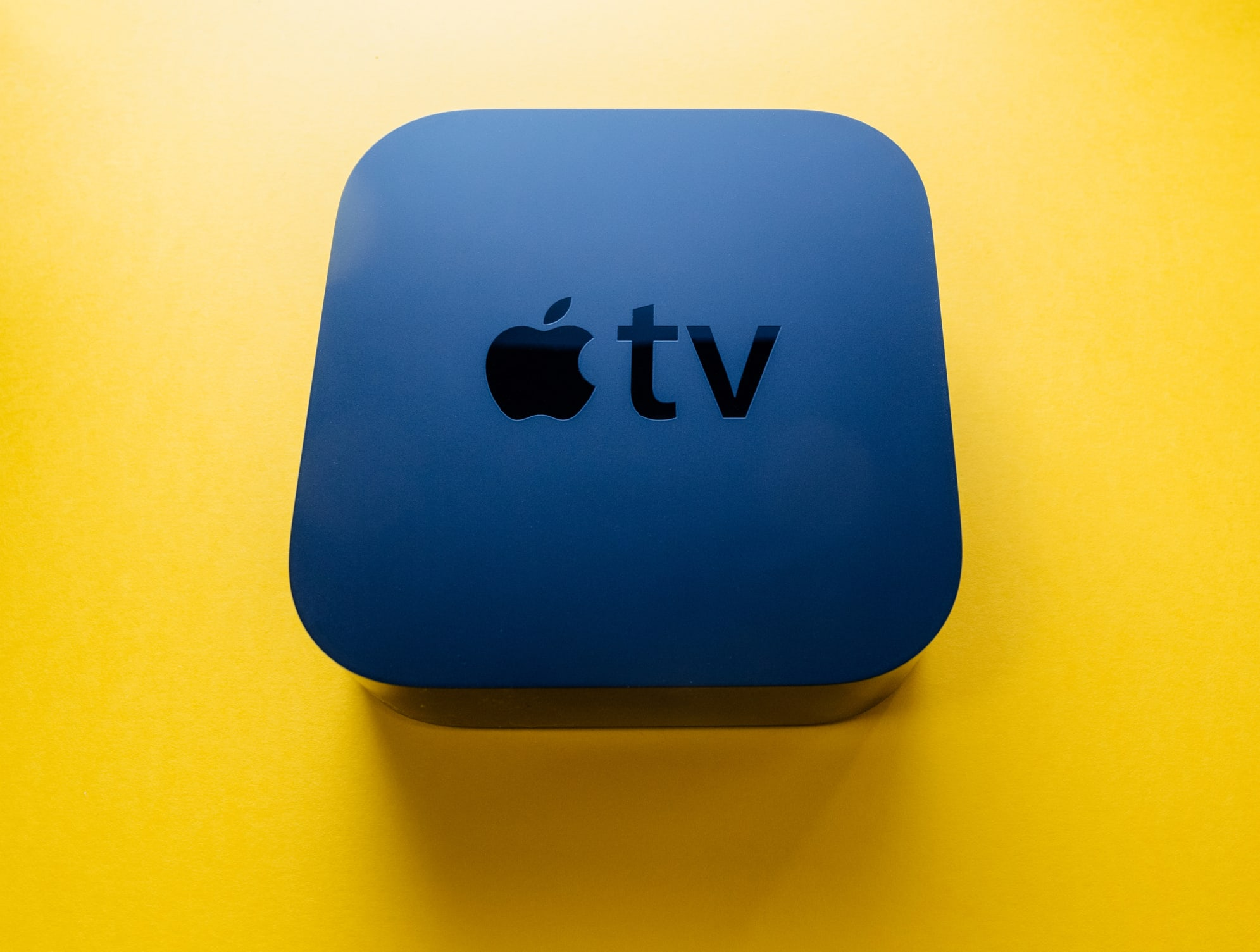 New Apple TV 4k Device Against Yellow Background