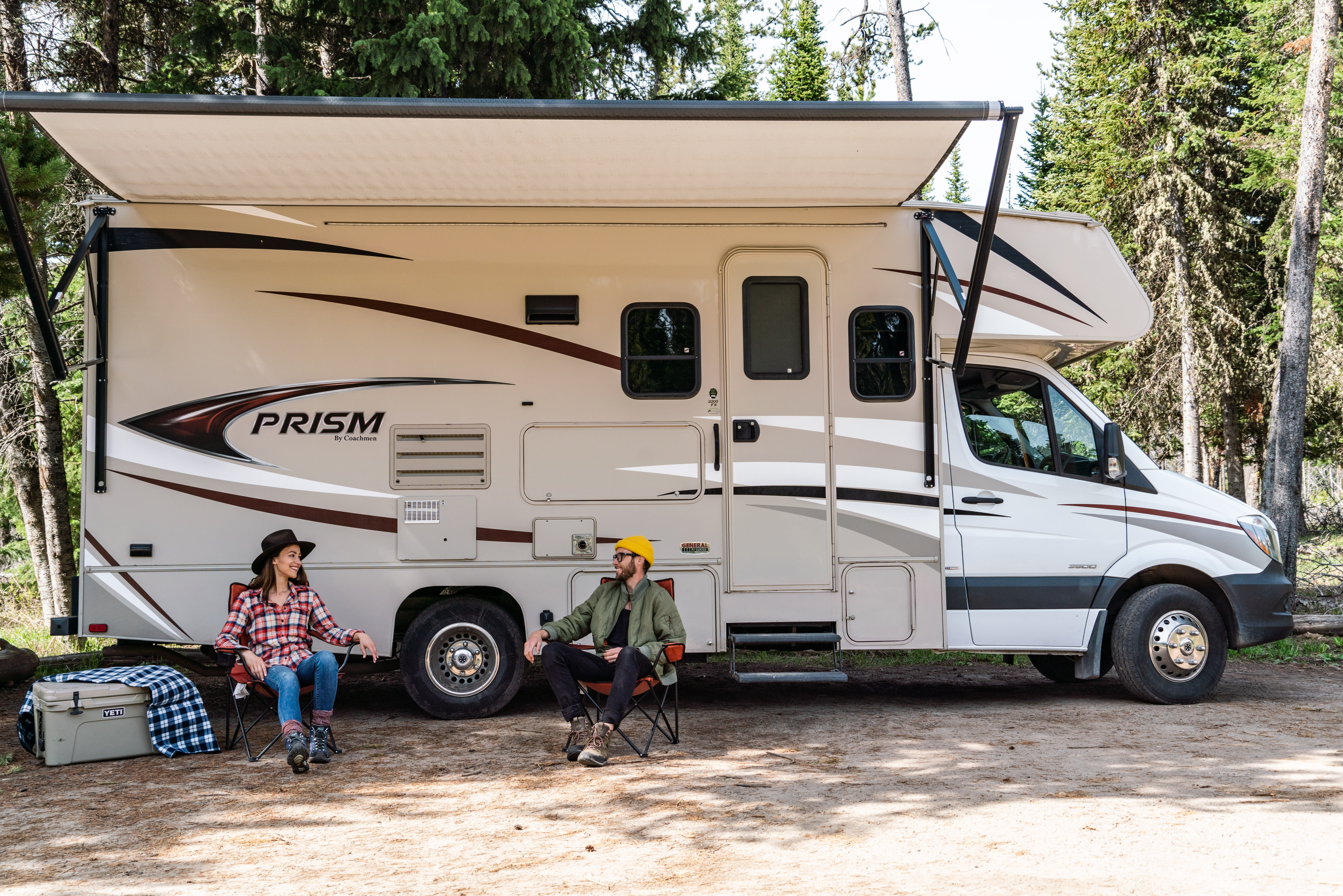 man and woman in front of RV