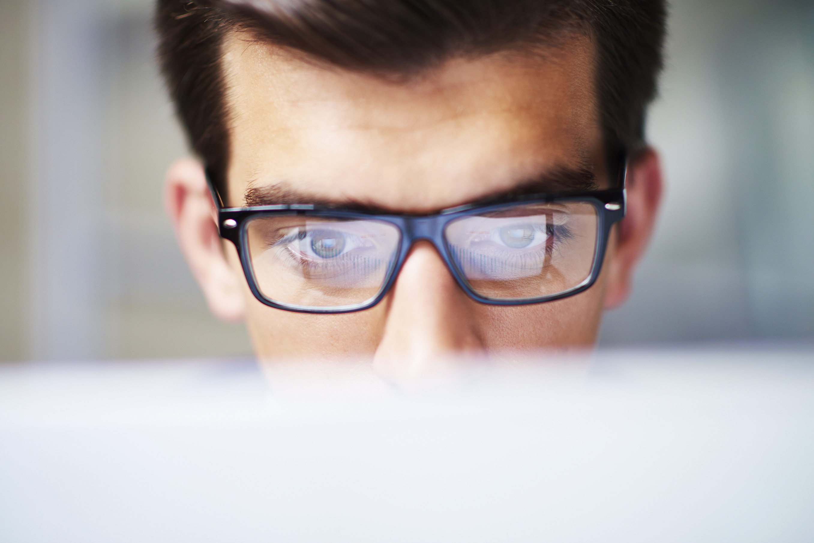 Men's eyes on computer screen