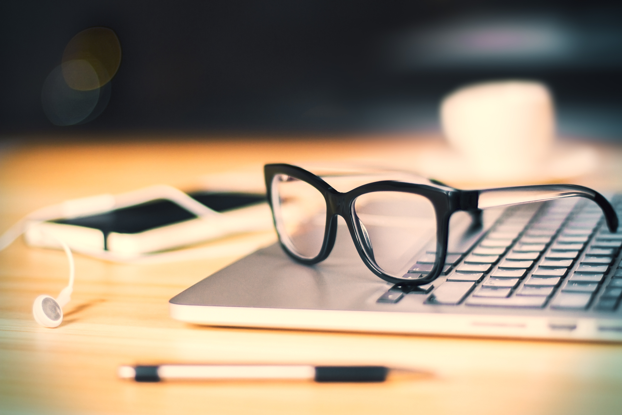 eyeglasses on laptop