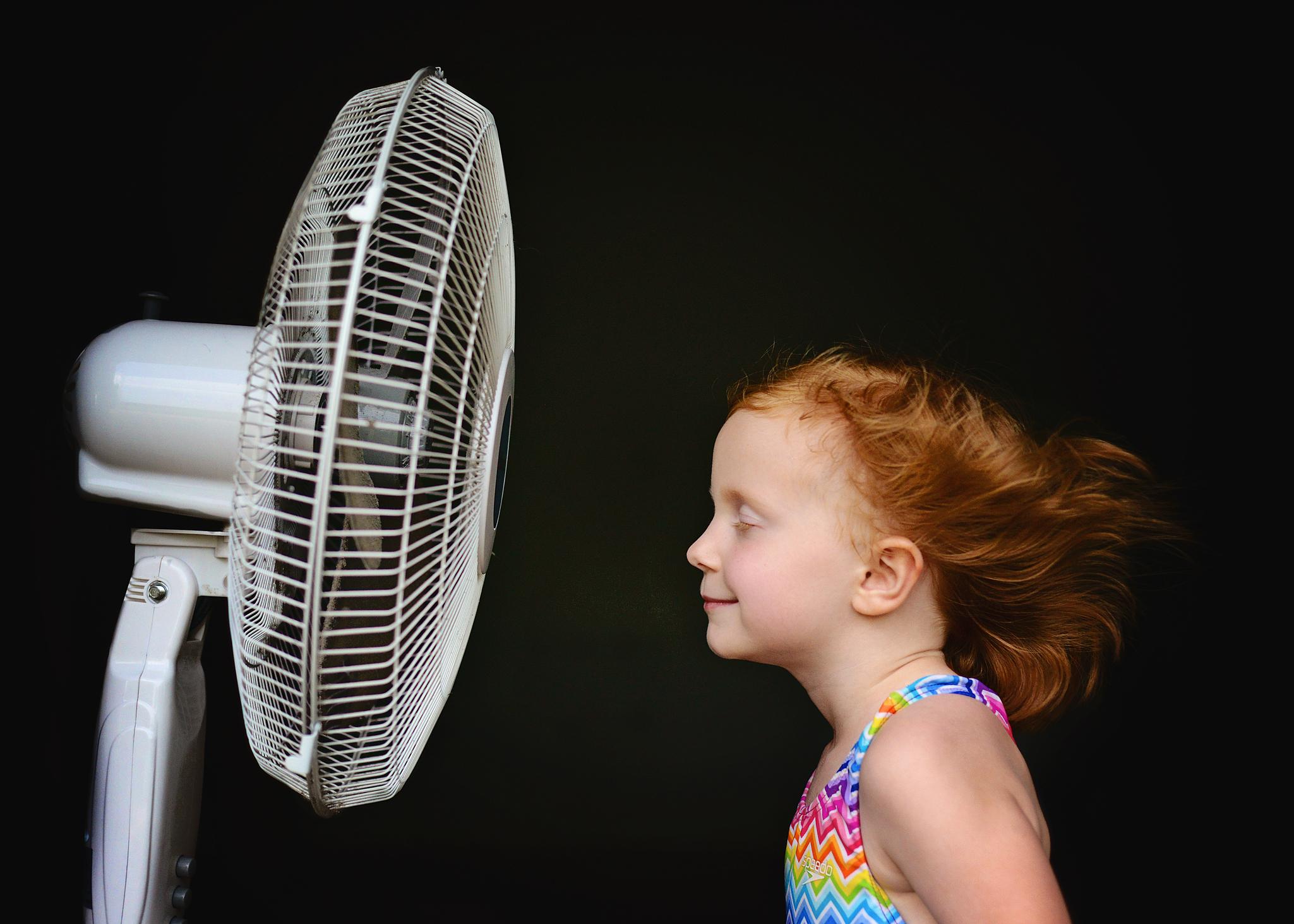 kid in front of fan