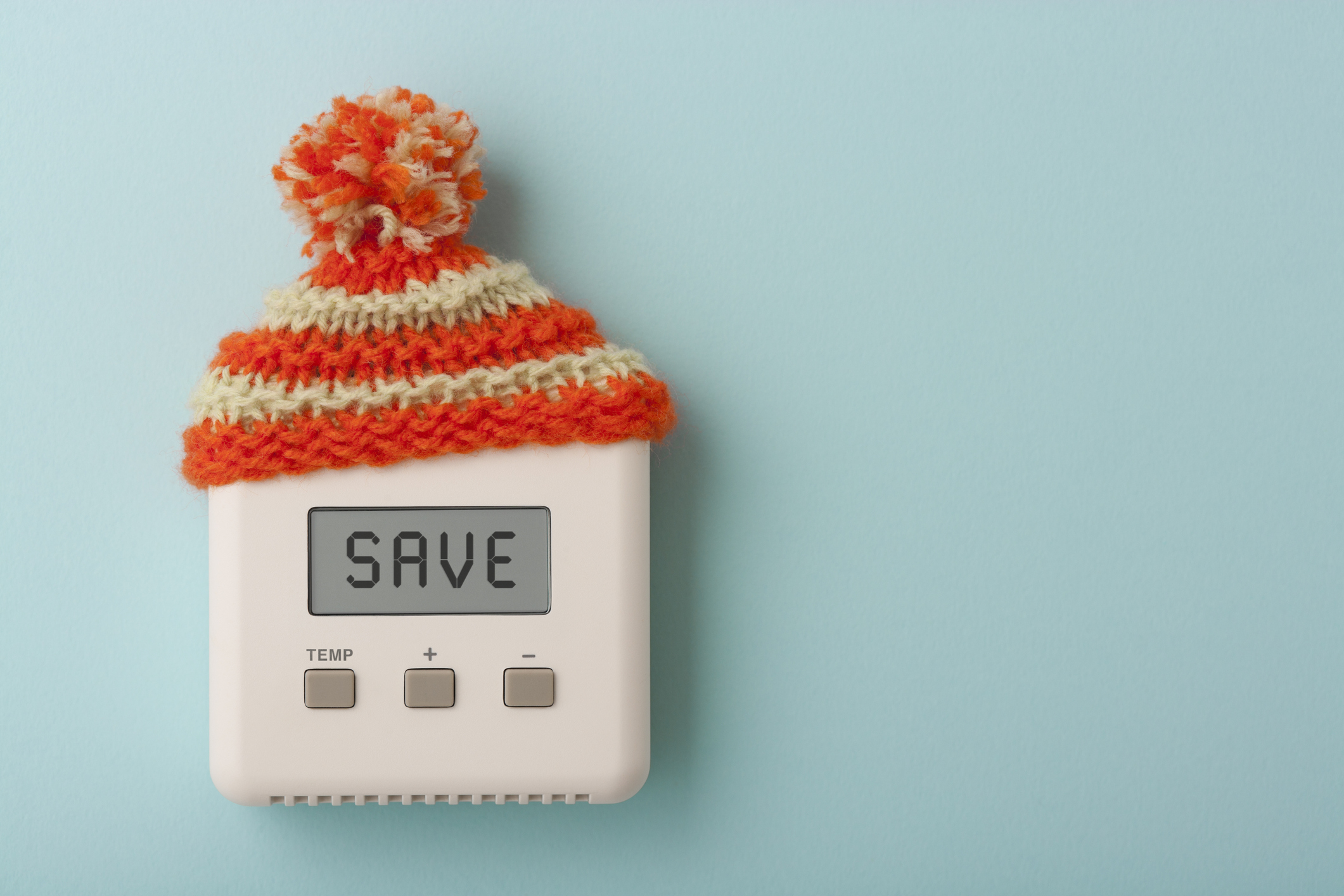 thermostat with hat on it