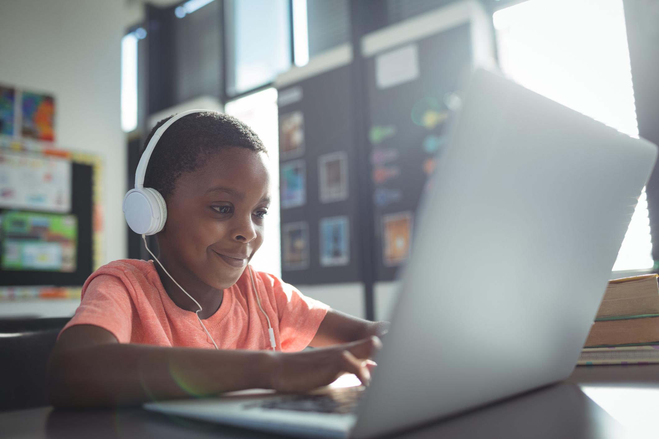 boy on laptop in class