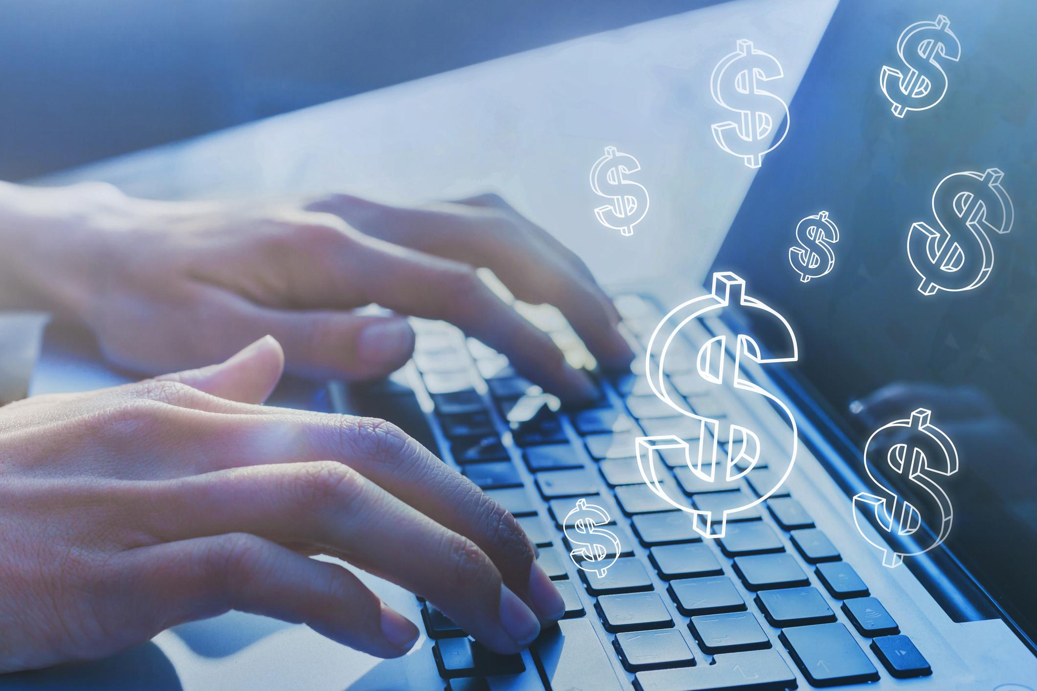 dollar signs around laptop