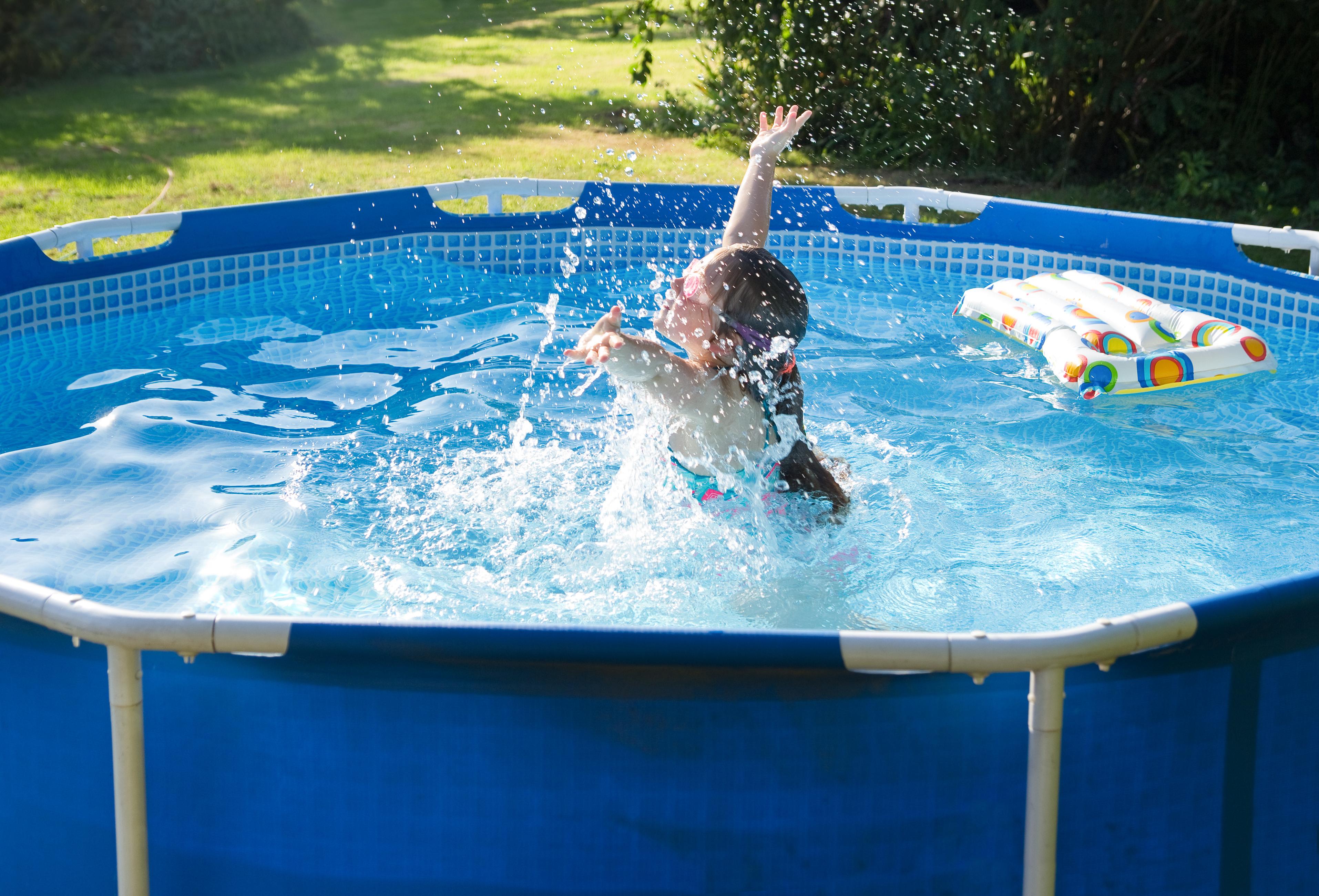 person splashing in pool